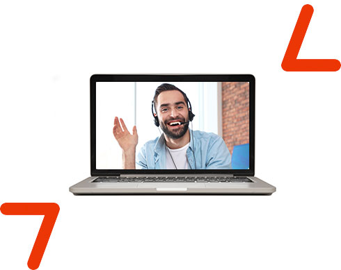 man with headphones waving hello on laptop screen