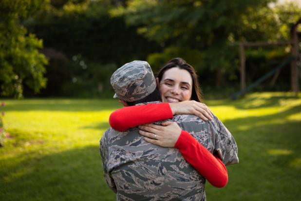 Soldier embracing female partner