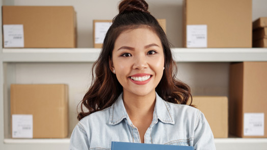 Woman in storage room holding a folder