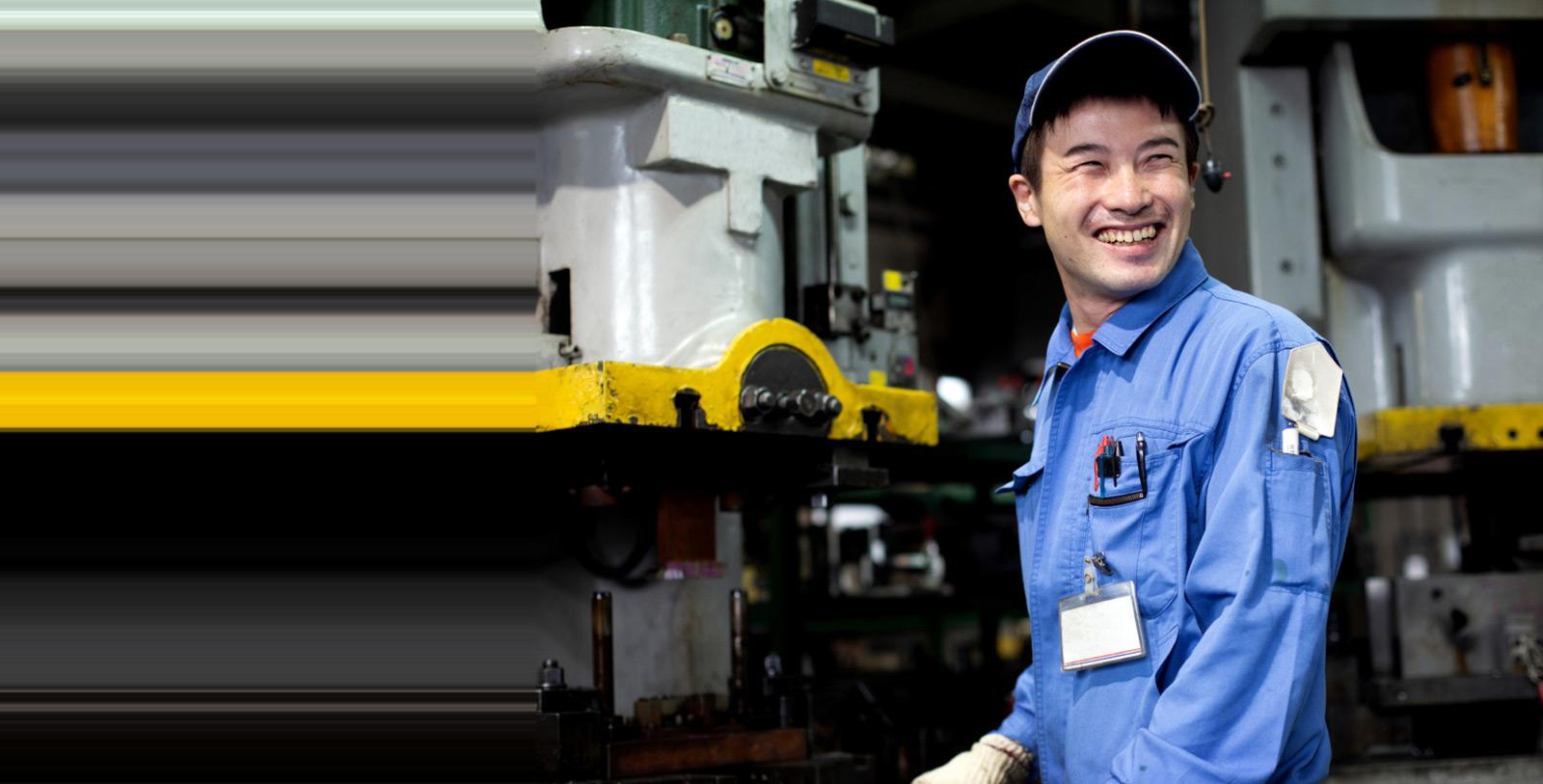 Auto mechanic poses in repair shop