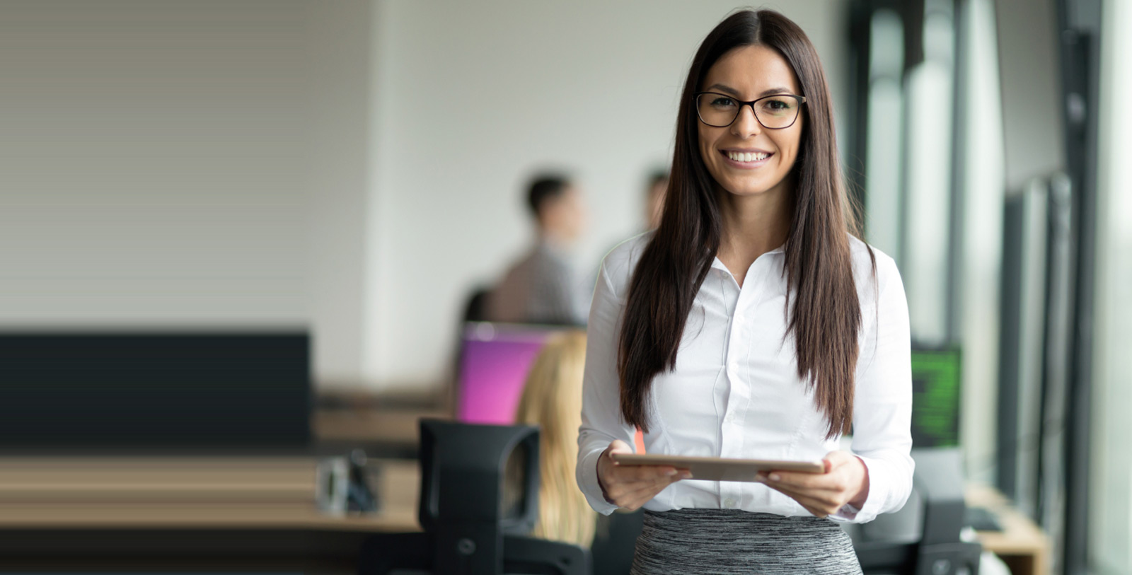 Female office worker holding a tablet