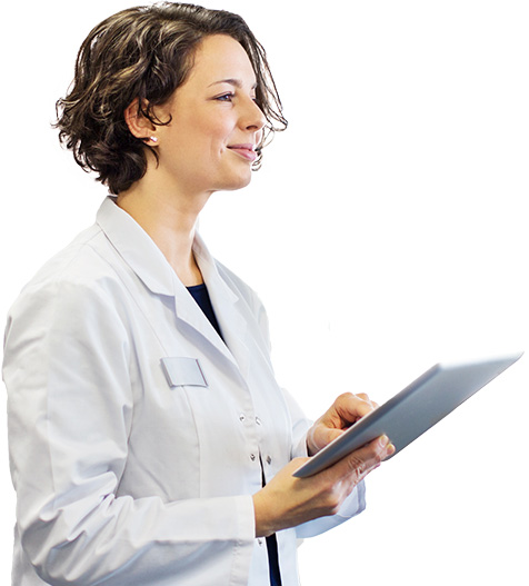 Female doctor smiling while reviewing charts with a patient.